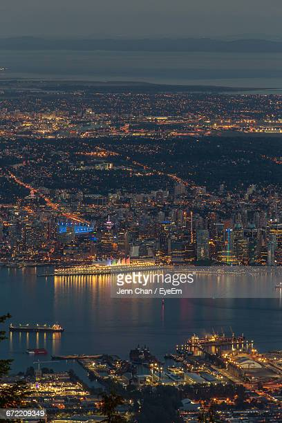 Aerial View Of Harbor Amidst Illuminated Cityscape At Night
