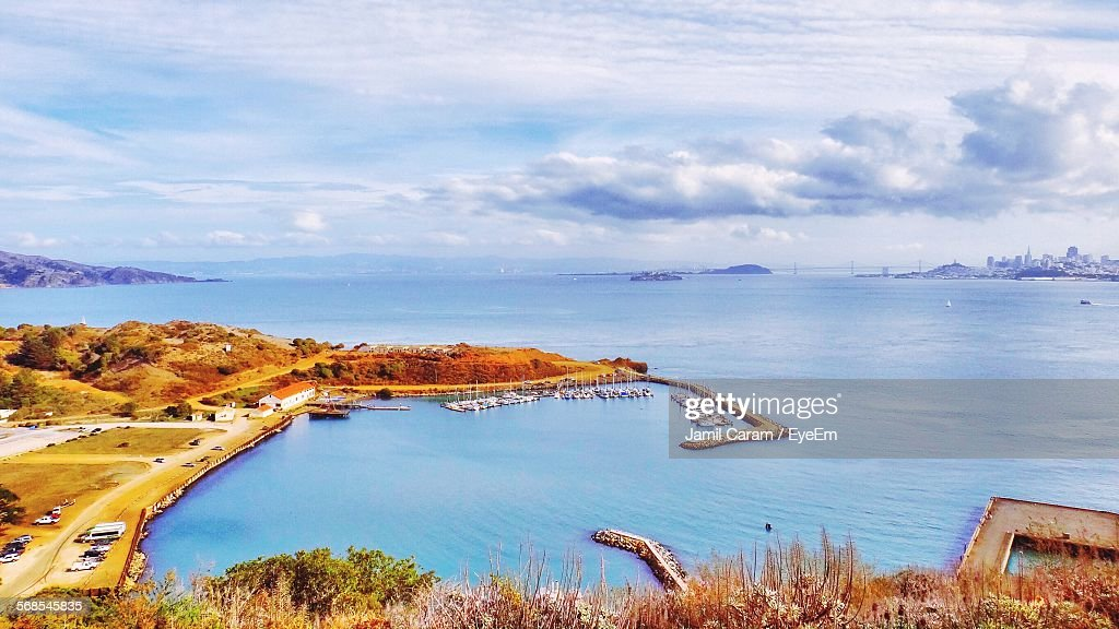 Aerial View Of Harbor By Sea Against Cloudy Sky : Stock Photo