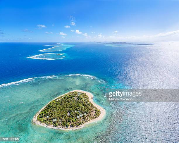 aerial view of heart shaped island tavarua, fiji - western division fiji stock photos and pictures