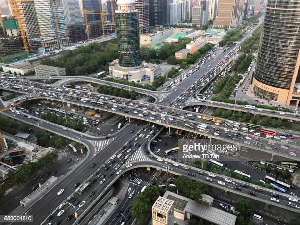 Aerial view of heavy traffic on a triple-layer flyover in the day time