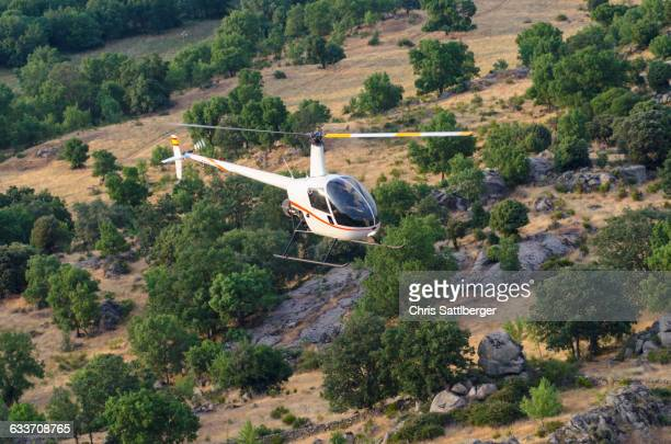 Aerial view of helicopter flying over remote landscape