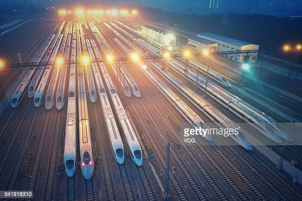 Aerial view of high-speed trains at a maintenance factory on June 20, 2016 in Zhengzhou, Henan Province of China. The factory undertook the check,...