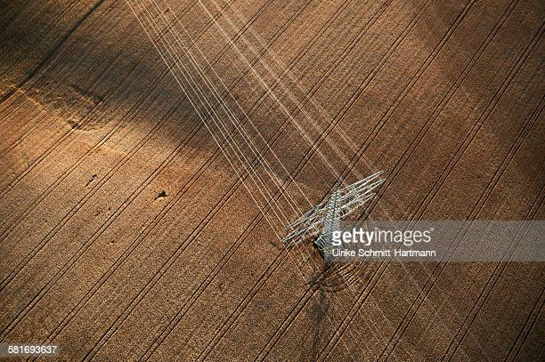 aerial view of high-voltage pole in cornfield - power line stock photos and pictures