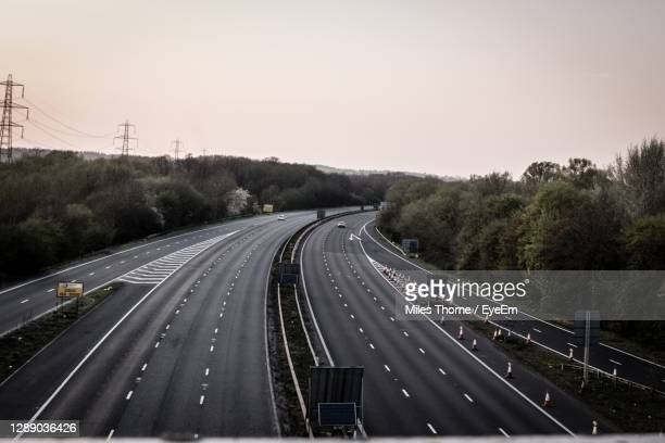 aerial view of highway against sky - motorway stock pictures, royalty-free photos & images