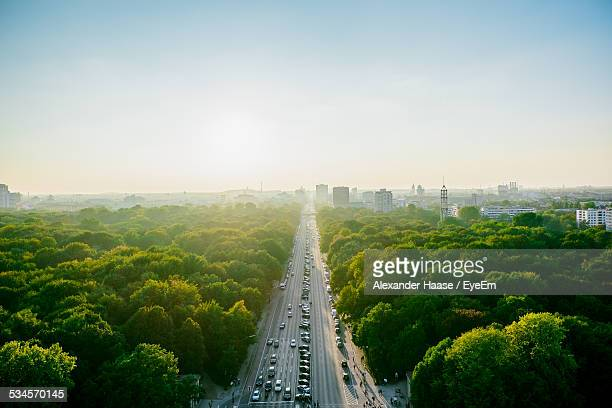 aerial view of highway amidst trees against clear sky - berlin stock-fotos und bilder