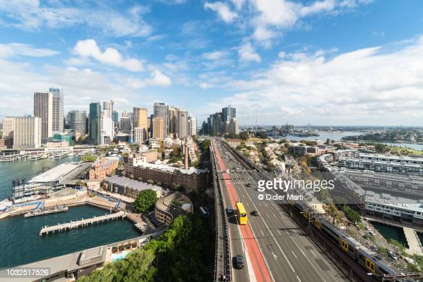 aerial view of highway and downtown district in sydney - public transport stock pictures, royalty-free photos & images