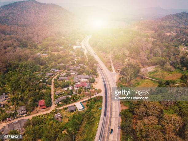 aerial view of highway and forest thailand - 4k resolution stock pictures, royalty-free photos & images