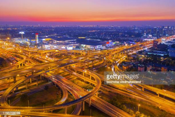 aerial view of highway at rush hour at night time with car trail and traffic. view from drone - moscow russia stock pictures, royalty-free photos & images