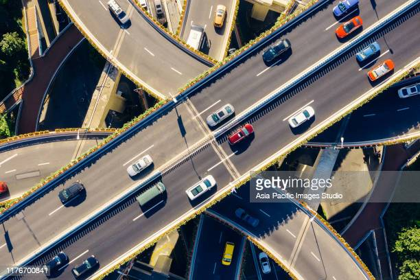 aerial view of highway at sunny day. - traffic stock pictures, royalty-free photos & images