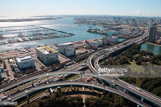 aerial view of highway by tokyo bay, koto ward, tokyo prefecture, honshu, japan - kanto region stock photos and pictures