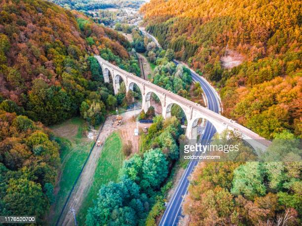 aerial view of highway, cars and viaduct bridge - romania stock pictures, royalty-free photos & images