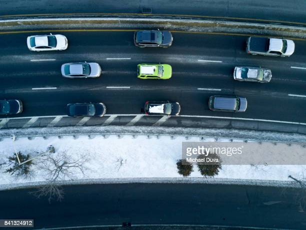 Aerial view of highway directly overhead with cars and snow