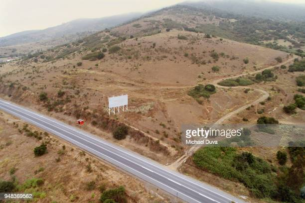 Aerial view of highway in country with blank billboard