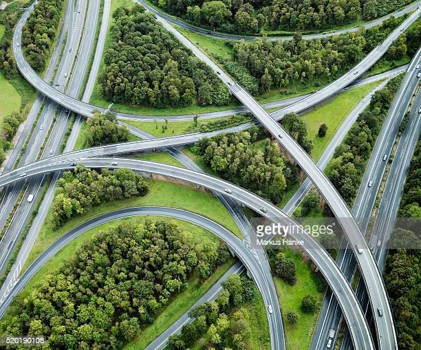 aerial view of highway intersection, germany - fernverkehr stock-fotos und bilder