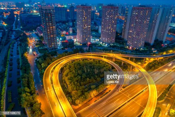aerial view of highway - liyao xie stock pictures, royalty-free photos & images
