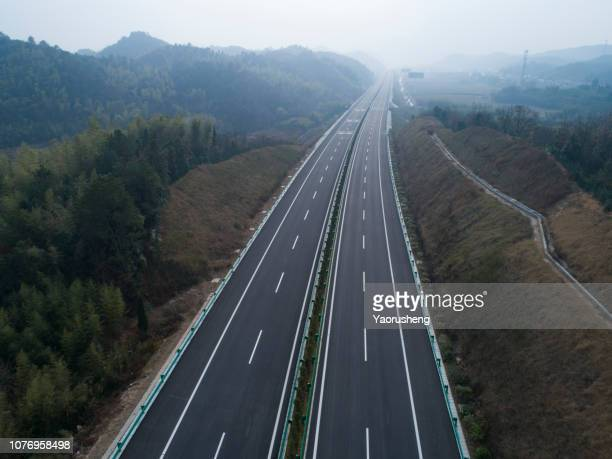 aerial view of highway - empty road stock pictures, royalty-free photos & images