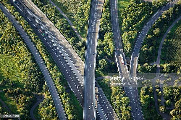 aerial view of highways through green nature - major road stock pictures, royalty-free photos & images