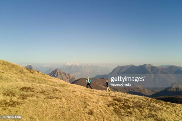 aerial view of hiking couple enjoying mountains - ascent xmedia stock pictures, royalty-free photos & images