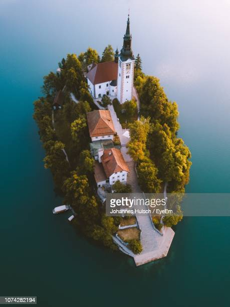 aerial view of historic building on island - slovenia stock pictures, royalty-free photos & images