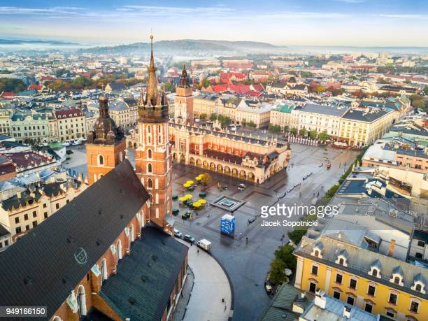 aerial view of historic market square at sunrise, krakow, poland - krakow stock pictures, royalty-free photos & images