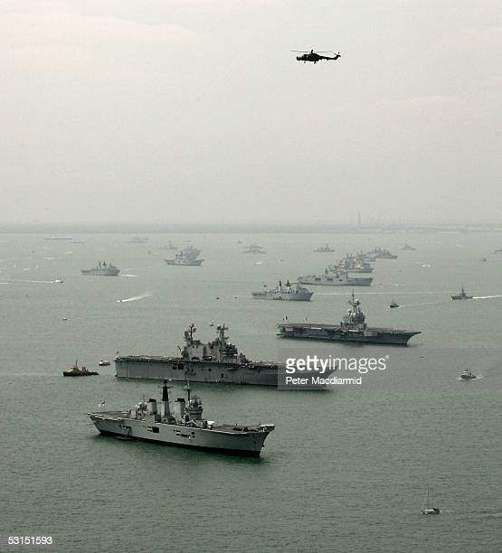 A aerial view of HMS Invincible USS Saipan and FS Charles de Gaulle with some of the 112 warships gathered in the Solent ahead of the International...