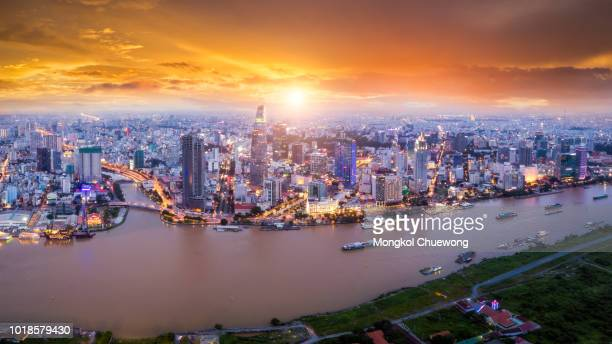 aerial view of ho chi minh city skyline and skyscrapers in center of heart business at ho chi minh city downtown. panorama of cityscape on saigon river in ho chi minh city at vietnam at sunset scene - ho chi minh city stock pictures, royalty-free photos & images