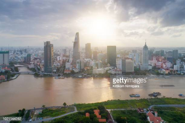 aerial view of ho chi minh modern office buildings, condominium, living place in ho chi minh city downtown with sunset scenery, ho chi minh is the most populated city in southeast asia.ho chi minh,vietnam. - free walpaper stock photos and pictures