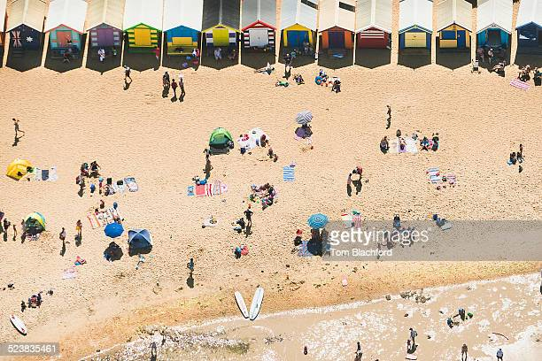 Aerial view of holiday makers and beach huts on Brighton beach, Melbourne, Victoria, Australia