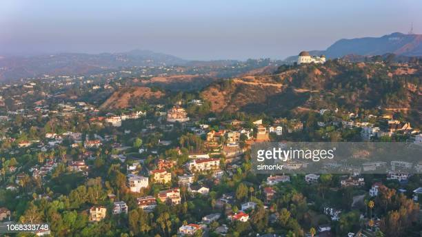 aerial view of hollywood hills with griffith observatory on the slope of mt. hollywood in the morning - hollywood hills stock pictures, royalty-free photos & images