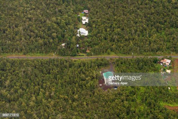 Aerial view of homes on either side of an unspecified road on the island of Hawaii Hawaii December 21 2007