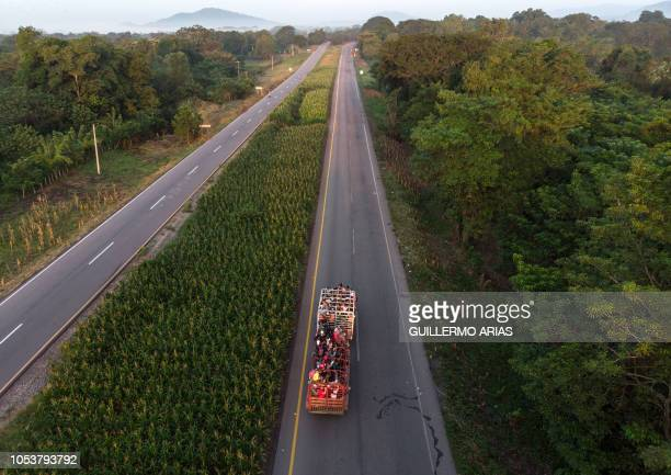 Aerial view of Honduran migrants aboard a truck heading in a caravan to the US near Pijijiapan southern Mexico on October 26 2018 The Pentagon is...