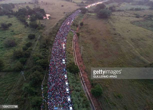 Aerial view of Honduran migrants heading in a caravan to the US as the leave Arriaga on their way to San Pedro Tapanatepec in southern Mexico on...