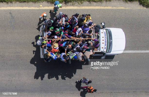 Aerial view of Honduran migrants onboard a truck as they take part in a caravan heading to the US in the outskirts of Tapachula on their way to...