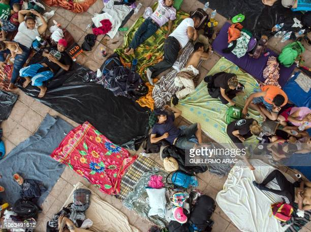TOPSHOT Aerial view of Honduran migrants taking part in a caravan heading to the US as they rest in the main square of Pijijiapan Chiapas state...