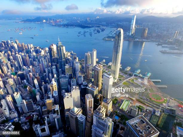 aerial view of hong kong city and victoria harbour - hong kong stock pictures, royalty-free photos & images