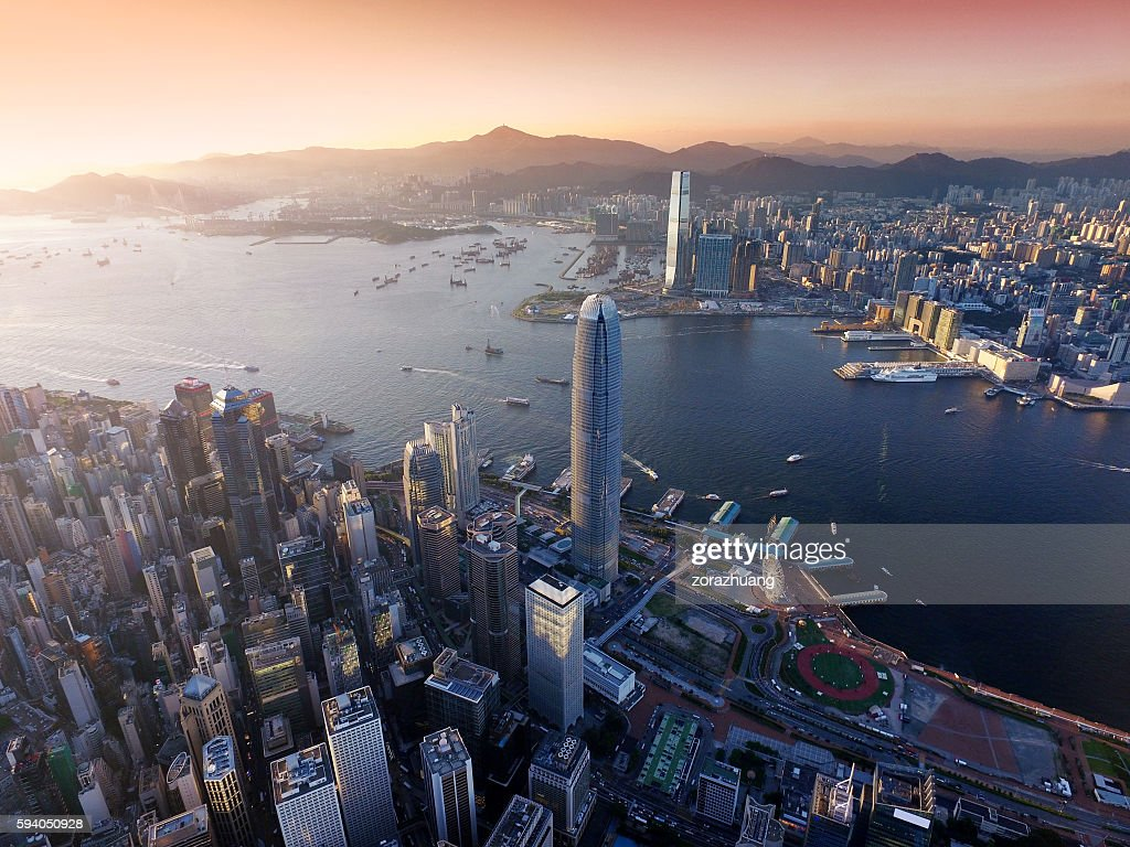 Aerial view of Hong Kong city, Victoria harbour in sunset : Stock Photo