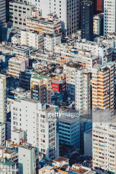 Aerial view of Hong Kong cityscape with local residential blocks on a clear sunny day