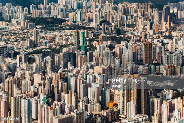 Aerial view of Hong Kong cityscape with modern skyscrapers on a clear sunny day