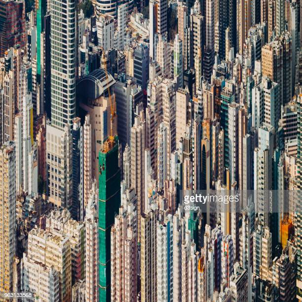 Aerial view of Hong Kong cityscape with urban skyscrapers on a clear sunny day