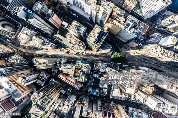 aerial view of hong kong downtown. financial district and business centers in smart city in asia. top view of skyscraper and high-rise buildings. - cityscape stock pictures, royalty-free photos & images