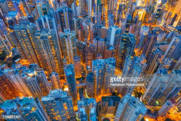 aerial view of hong kong downtown, republic of china. financial district and business centers in smart city in asia. top view of skyscraper and high-rise buildings - china oost azië stockfoto's en -beelden