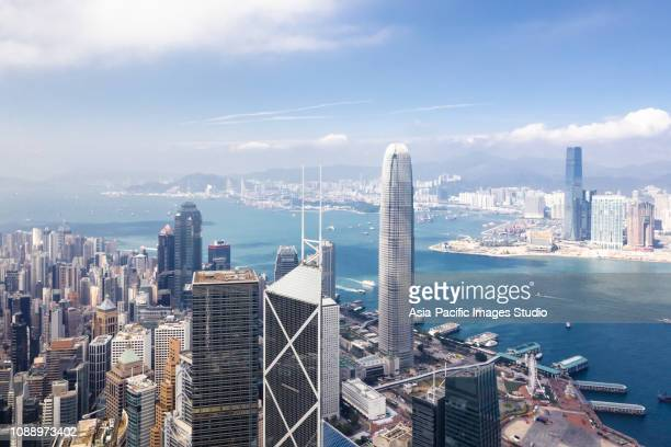 aerial view of hong kong financial district - hong kong stock pictures, royalty-free photos & images