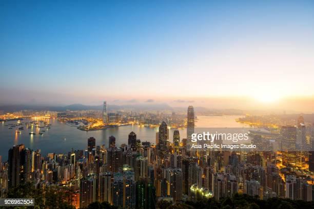 Aerial view of Hong Kong skyline at sunrise.