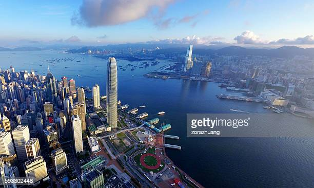 aerial view of hong kong, victoria harbour in sunrise - hongkong 個照片及圖片檔