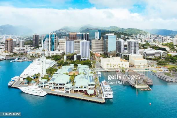 aerial view of honolulu harbor, aloha tower & marketplace and downtown city skyline, hawaii - honolulu imagens e fotografias de stock