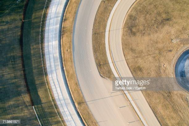 aerial view of horseracing track on sunny day - horse racecourse stock photos and pictures