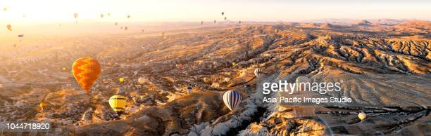 aerial view of hot air balloons over cappadocia at sunrise,turkey(panorama xxl) - cappadocia stock pictures, royalty-free photos & images