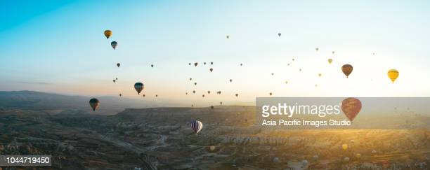 aerial view of hot air balloons over cappadocia at sunrise,turkey(panorama xxl) - country geographic area stock pictures, royalty-free photos & images