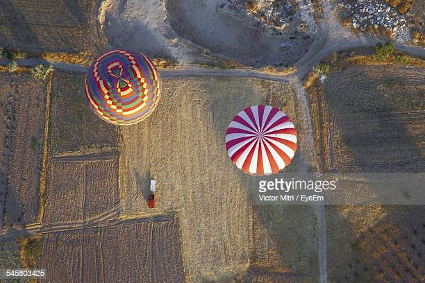 Aerial View Of Hot Air Balloons Over Landscape