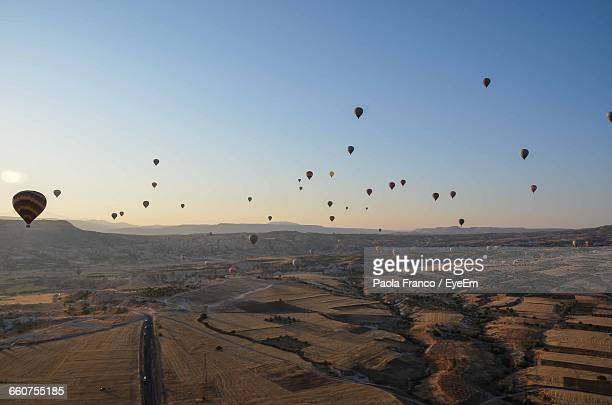 Aerial View Of Hot Air Balloons Over Vast Landscape